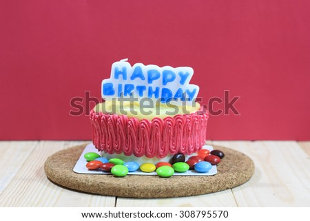 Birthday cake decorated red background