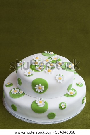 Birthday cake decorated with sugar flowers - stock photo