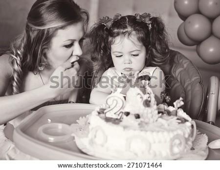 birthday cake of little sweet toddler girl - stock photo