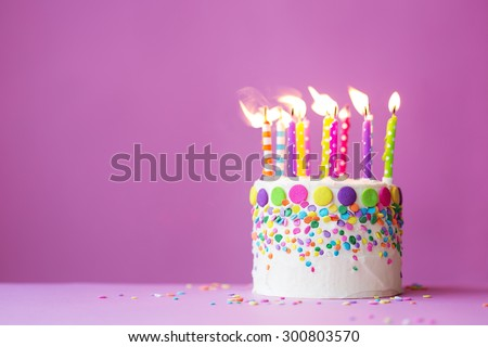 Birthday cake on a pink background - stock photo