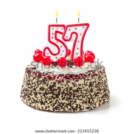 Birthday cake with burning candle number 57 - stock photo