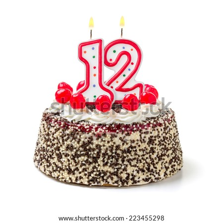 Birthday cake with burning candle number 12 - stock photo