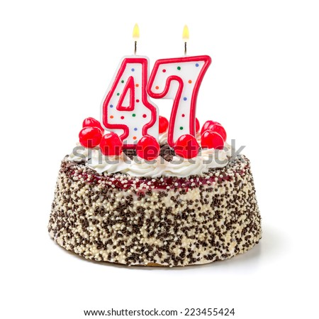 Birthday cake with burning candle number 47 - stock photo