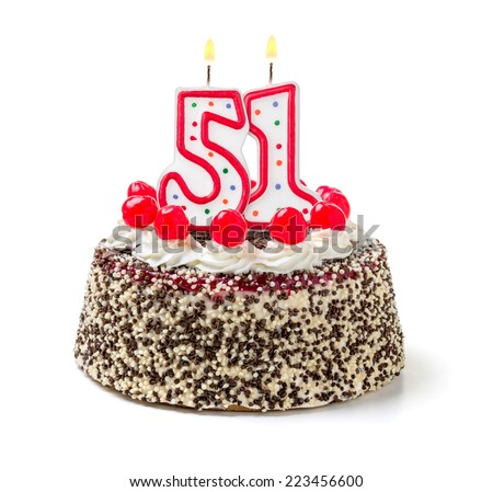 Birthday cake with burning candle number 51 - stock photo