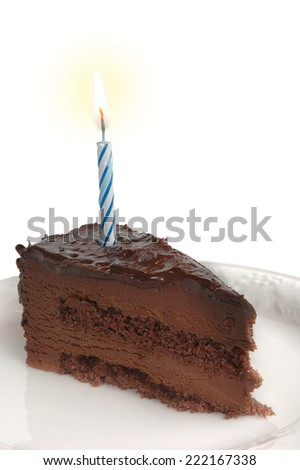 Birthday cake with burning candle studio isolated on white background - stock photo