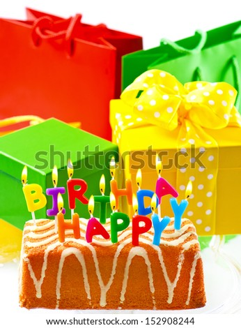 birthday cake with burning candles and gifts. happy birthday to you. card concept