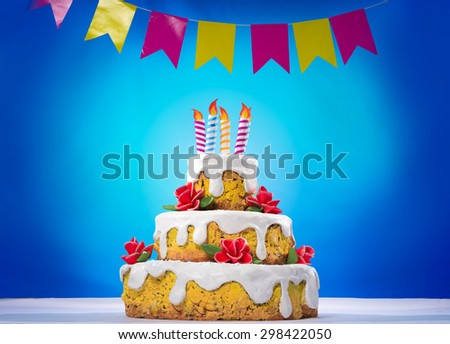Birthday cake with candles and white cream - stock photo
