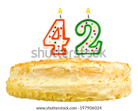 birthday cake with candles number forty two isolated on white background - stock photo