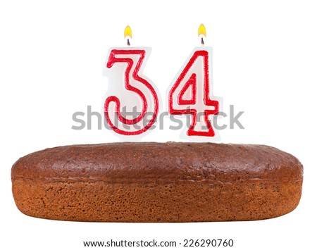 birthday cake with candles number 34 isolated on white background