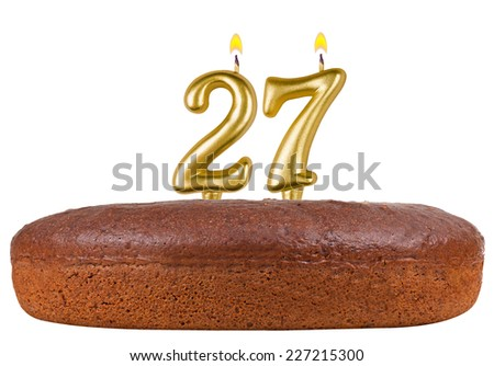 birthday cake with candles number 27 isolated on white background - stock photo