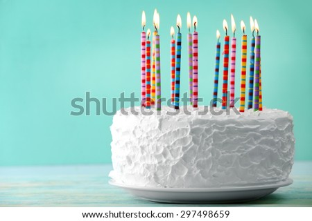 birthday cake candles on color background stock photo