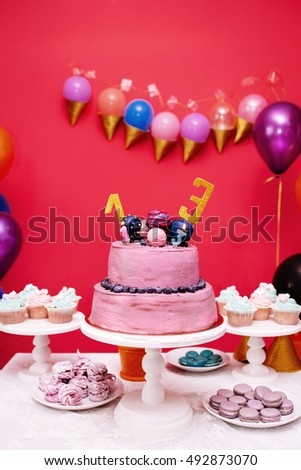 Birthday cake with candles on colorful background. Festive table