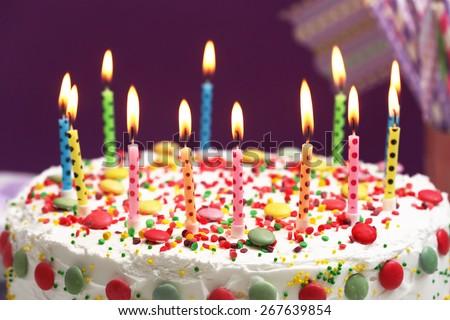 Birthday Cake Candles On Purple Background Stock Photo 268518032