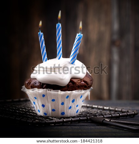 birthday cake with candles on rustic background - stock photo