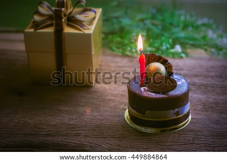 Birthday cake with candles on wooden background. - stock photo