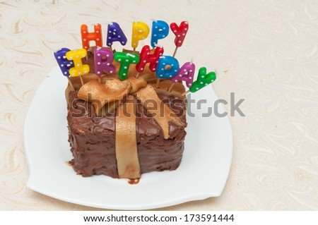 Birthday cake with chocolate and  candles isolated. Colored candles. birthday gift . Enjoy . Celebrate with cake and wine. with love. Many happy birthdays. Live long. light your birthday candles - stock photo