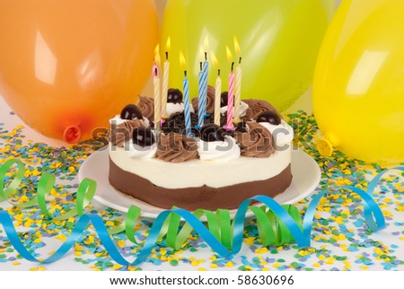 Birthday cake with colorful decoration - stock photo