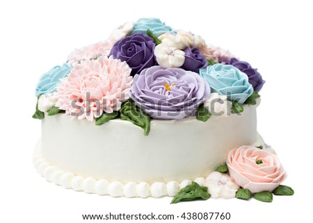 Birthday cake with colorful flowers isolated on white background - stock photo