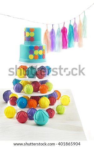 Birthday cake with decorations over white background - stock photo