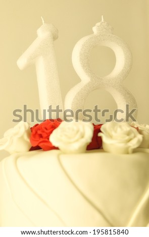 Birthday cake with red and white rose decorations and candles  - stock photo