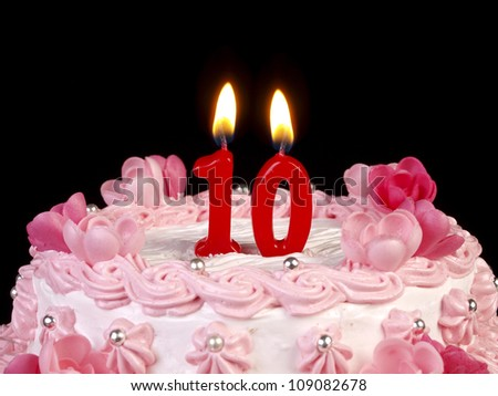 Birthday cake with red candles showing Nr. 10 - stock photo