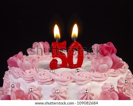 Birthday cake with red candles showing Nr. 50 - stock photo