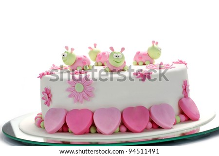 birthday cake with white frosting and ladybugs - stock photo