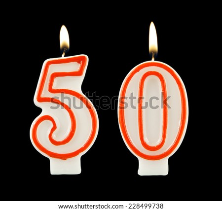 Birthday candle on black background, number 50 - stock photo