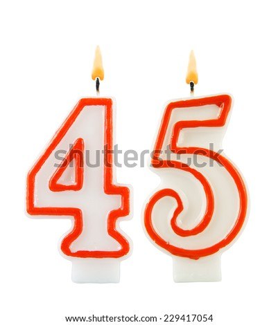 Birthday candle on black background, number 45 - stock photo