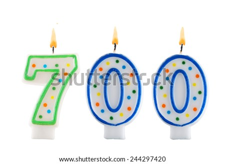 Birthday candle on white background, number 700  - stock photo