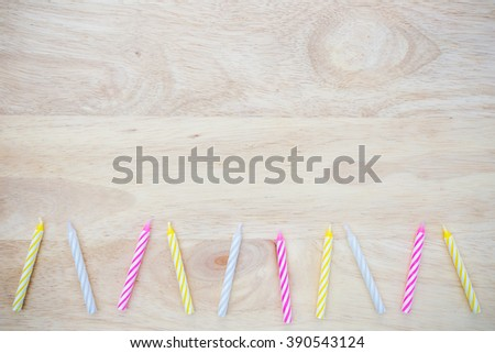birthday candle placed on wood - stock photo
