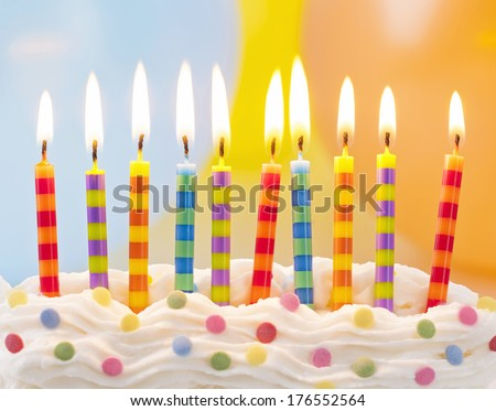 Birthday candles on colorful background - stock photo