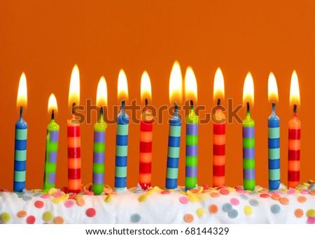 Birthday candles on orange background - stock photo