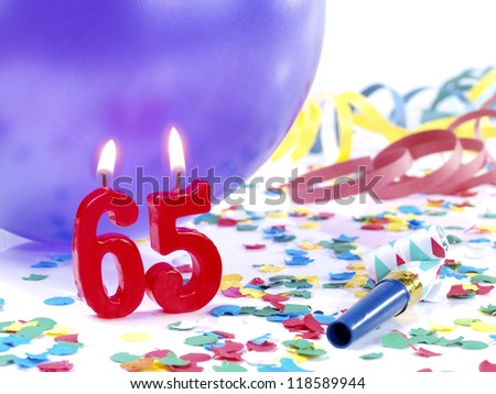 Birthday candles showing Nr. 65 - stock photo