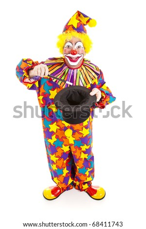 Birthday clown does a magic trick.  Full body isolated on white.