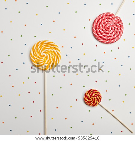 Birthday Concept - Holiday Food Top View Various Sweet Candies on White Background. Fun Decoration. Minimal Holiday Concept. Flat Lay