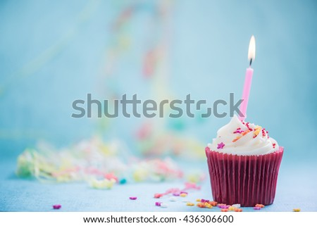 birthday cupcake background with copy space - stock photo