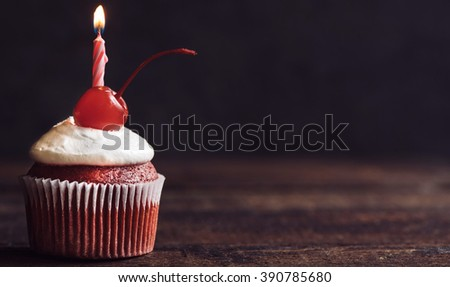 Birthday cupcake with candle on wooden background,selective focus and copy space  - stock photo