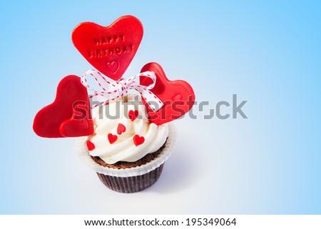 Birthday cupcake with hearts - stock photo