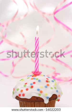birthday cupcake with pink candle
