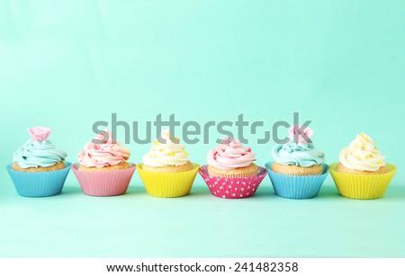 Birthday cupcakes on green background - stock photo