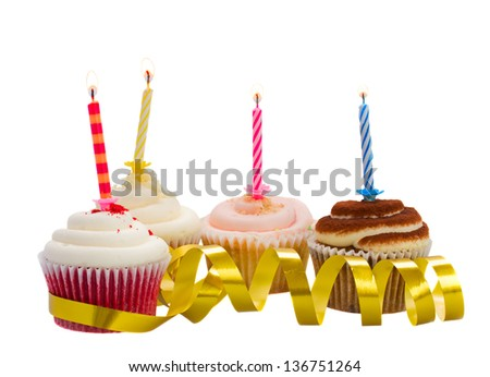 birthday cupcakes with burning candles isolated on white background
