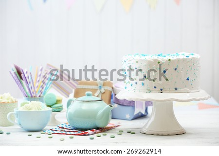 Birthday decorated cake on white wall background - stock photo