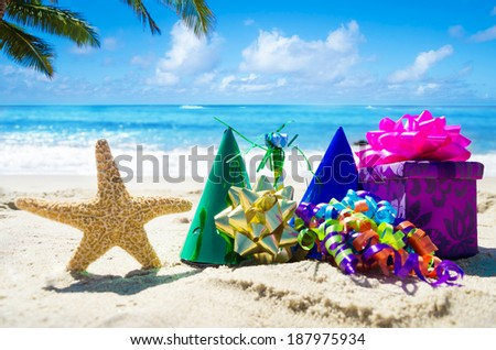 Birthday decorations on the sandy beach by the ocean - stock photo