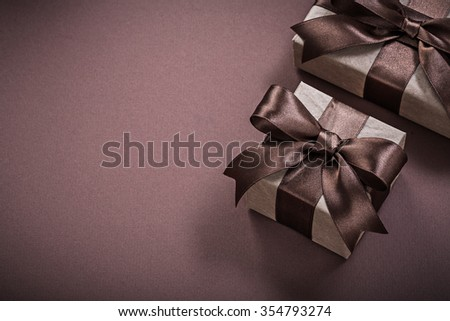 Birthday gift boxes on brown background holidays concept.