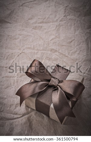 Birthday giftbox with brown tape on wrapping paper holidays concept.