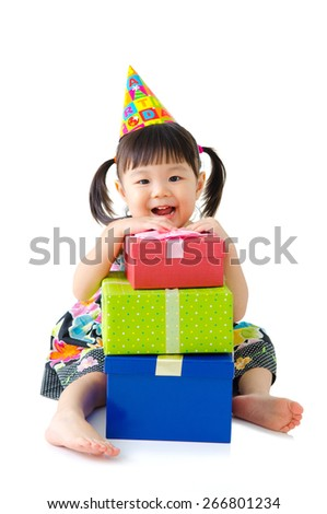 Birthday girl and her presents - stock photo