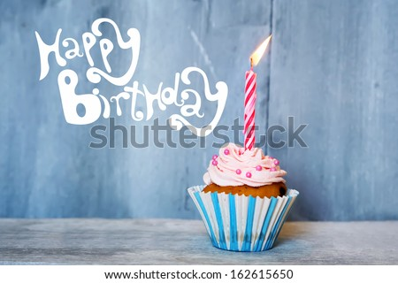 Birthday greeting card with cupcake and candle - stock photo