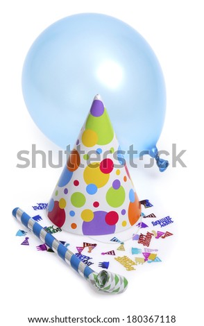Birthday hat with blue balloon and noise maker on white background - stock photo