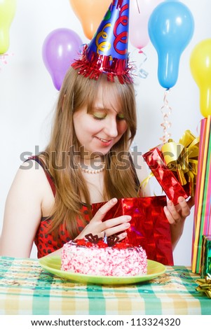 Birthday of a young girl. Opening the gifts